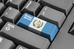 Entre en el botón con la bandera de Guatemala Imágenes de archivo libres de regalías