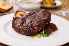 Entrecote with grilled garlic Stock Photos