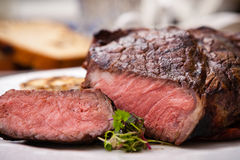 Entrecote with grilled garlic Royalty Free Stock Photos
