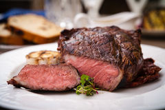 Entrecote with grilled garlic Royalty Free Stock Photography