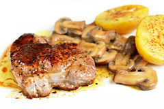 Entrecote served with mushrooms Royalty Free Stock Photography