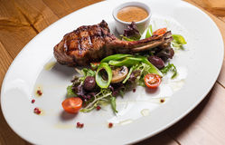 Entrecote steak meat with grilled vegetables. On white plate Stock Photos