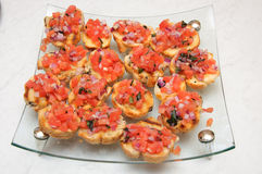 Entree. Finger food garnish detail tomato bruschetta Royalty Free Stock Photography