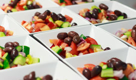 Entree Greek Salad prepared for catering. Greek Salad entree prepared for big function in restaurant Royalty Free Stock Photos