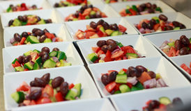 Entree Greek Salad prepared for catering. Greek Salad entree prepared for big function in restaurant Stock Photography