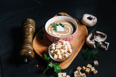 Entree at restaurant, creamy delicious mushroom cream soup served hot and chilli. Top view of entree at restaurant, creamy delicious mushroom cream soup served Stock Photos