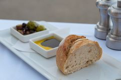 Entree, starter meal of bread with olive oil and balsamic vinegar and olives. Bread slices with olive oil and balsamic vinegar and olives entree, starter meal at royalty free stock photos