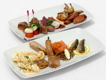 Entree Tasting Plates. Containing an assortment of seafood and meats Stock Photo