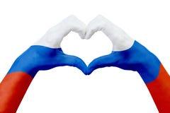 Entrega a bandeira de Rússia, dão forma a um coração Conceito do símbolo do país, isolado no branco Foto de Stock Royalty Free