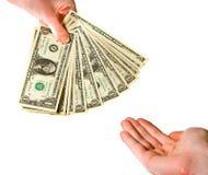 Entrega de billetes de banco del dólar Fotografía de archivo libre de regalías