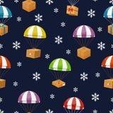 Entrega do presente no céu do inverno com flocos de neve Fotos de Stock