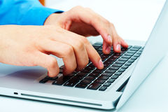 Entrega el teclado Fotografía de archivo libre de regalías