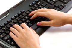 Entrega el teclado Imagen de archivo libre de regalías