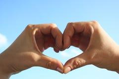 Entrega o coração no céu Imagem de Stock Royalty Free