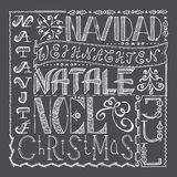 Entregue a colagem tirada do cartaz do Natal com línguas diferentes Foto de Stock Royalty Free