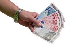 Entregue com o dinheiro dos euro isolado no fundo branco Foto de Stock Royalty Free