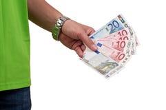 Entregue com o dinheiro dos euro isolado no fundo branco Imagens de Stock Royalty Free