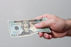 Entregue a doação do dinheiro Imagem de Stock Royalty Free
