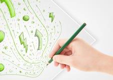 Entregue esboços e garatujas abstratos de tiragem no papel Fotografia de Stock