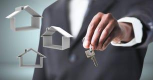 Entregue guardar chave com ícones home na frente da vinheta Fotos de Stock Royalty Free