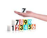 Entregue guardar números plásticos coloridos no fundo branco, No1 Foto de Stock Royalty Free