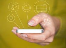 Entregue guardar o smartphone com ícones e conceito dos símbolos Foto de Stock