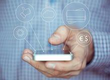 Entregue guardar o smartphone com ícones e conceito dos símbolos Imagens de Stock