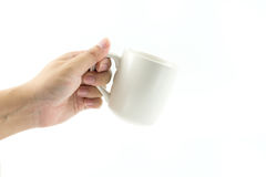 Entregue guardar o vidro de leite, conceito da dieta saudável, isolado em b branco Fotos de Stock Royalty Free