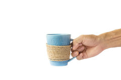 Entregue guardar um fundo branco isolado da caneca de café Foto de Stock Royalty Free