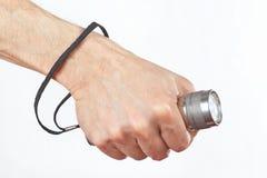 Entregue guardar uma lanterna conduzida no fundo branco Fotografia de Stock