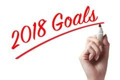 Entregue guardar uma pena e a escrita de 2018 objetivos Imagens de Stock Royalty Free