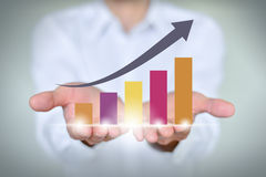 Entregue guardar uma seta de aumentação, crescimento do negócio Imagem de Stock
