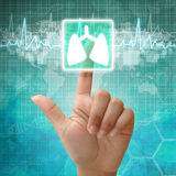 Entregue a imprensa no símbolo do pulmão, fundo médico imagens de stock royalty free