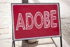 Entregue a inspiração do subtítulo do texto da escrita que mostra o nome de empresa de software do significado do conceito de ADO Foto de Stock