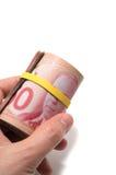 Entregue manter um rolo de 50 dólares canadense Fotografia de Stock Royalty Free