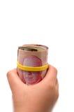 Entregue manter um rolo de 50 dólares canadense Imagens de Stock