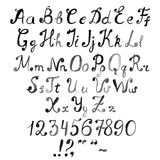 Entregue o alfabeto, números e pontuações tirados da aquarela do vetor Imagem de Stock