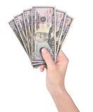 Entregue o dinheiro do dinheiro da terra arrendada no branco Foto de Stock Royalty Free