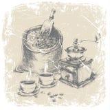 Entregue o saco do desenho do café, do moedor de café do vintage e das duas xícaras de café na tabela, quadro do grunge, monocrom Fotos de Stock