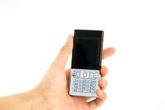 Entregue prender um telefone de pilha - fundo branco Imagens de Stock
