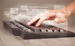 Entregue teclado tocante com elevação - botões da tecnologia Fotografia de Stock Royalty Free