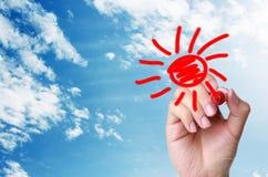 Entregue a tração o sol dos desenhos animados no céu Fotografia de Stock