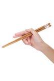 Entregue usando chopsticks Imagens de Stock Royalty Free