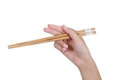 Entregue usando chopsticks Foto de Stock