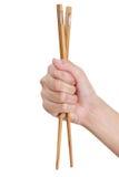 Entregue usando chopsticks Fotos de Stock Royalty Free