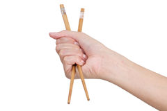 Entregue usando chopsticks Fotografia de Stock