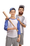 Entrenador de béisbol con un jugador adolescente Fotos de archivo