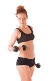 Entrenamiento de la mujer joven con pesas de gimnasia Fotos de archivo