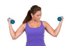 Entrenamiento de la pesa de gimnasia de la mujer Imagen de archivo libre de regalías