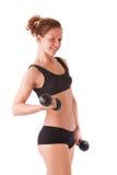 Entrenamiento femenino joven con pesas de gimnasia Imagenes de archivo